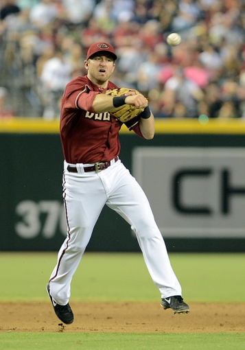 Jul 28, 2013; Phoenix, AZ, USA; Arizona Diamondbacks infielder Cliff Pennington (4) makes the force out at first against the San Diego Padres at Chase Field. The Padres defeated the Diamondbacks 1-0. Mandatory Credit: Jennifer Stewart-USA TODAY Sports