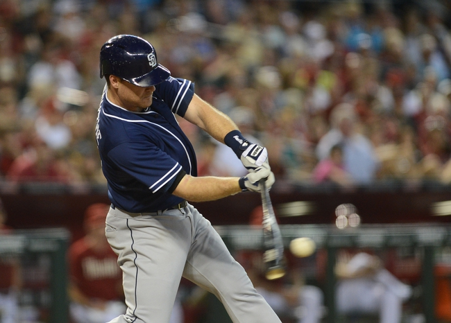 Jul 28, 2013; Phoenix, AZ, USA; San Diego Padres infielder Logan Forsythe (11) singles to center against the Arizona Diamondbacks in the seventh inning at Chase Field. The Padres defeated the Diamondbacks 1-0. Mandatory Credit: Jennifer Stewart-USA TODAY Sports