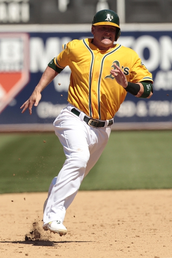 Jul 28, 2013; Oakland, CA, USA; Oakland Athletics infielder Josh Donaldson (20) runs towards third base against the Los Angeles Angels in the sixth inning at O.co Coliseum. Mandatory Credit: Cary Edmondson-USA TODAY Sports