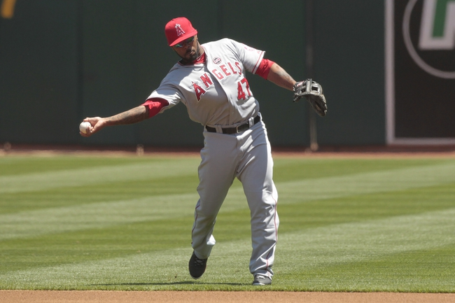 Jul 28, 2013; Oakland, CA, USA; Los Angeles Angels infielder Howie Kendrick (47) throws the ball to first to record an out against the Oakland Athletics in the first inning at O.co Coliseum. The Athletics defeated the Angels 10-6. Mandatory Credit: Cary Edmondson-USA TODAY Sports