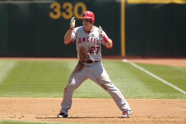Jul 28, 2013; Oakland, CA, USA; Los Angeles Angels outfielder Mike Trout (27) takes a lead off of first base against the Oakland Athletics in the second inning at O.co Coliseum. The Athletics defeated the Angels 10-6. Mandatory Credit: Cary Edmondson-USA TODAY Sports