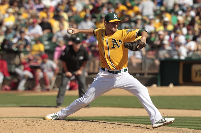 Jul 28, 2013; Oakland, CA, USA; Oakland Athletics pitcher Dan Otero (61) prepares to deliver a pitch against the Los Angeles Angels in the ninth inning at O.co Coliseum. The Athletics defeated the Angels 10-6. Mandatory Credit: Cary Edmondson-USA TODAY Sports