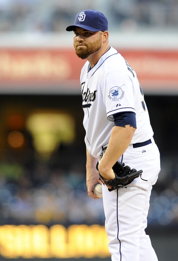 Jul 29, 2013; San Diego, CA, USA; San Diego Padres starting pitcher Sean O'Sullivan (59) looks in for a sign during the first inning against the Cincinnati Reds at Petco Park. . Mandatory Credit: Christopher Hanewinckel-USA TODAY Sports