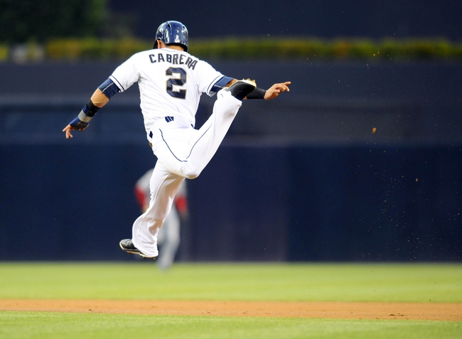 Jul 29, 2013; San Diego, CA, USA; San Diego Padres shortstop Everth Cabrera (2) jumps over a ground ball while stealing second base during the first inning against the Cincinnati Reds at Petco Park. Mandatory Credit: Christopher Hanewinckel-USA TODAY Sports
