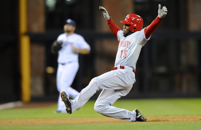 Jul 29, 2013; San Diego, CA, USA; Cincinnati Reds center fielder Derrick Robinson (15) slides into third base for a triple during the fifth inning against the San Diego Padres at Petco Park. . Mandatory Credit: Christopher Hanewinckel-USA TODAY Sports