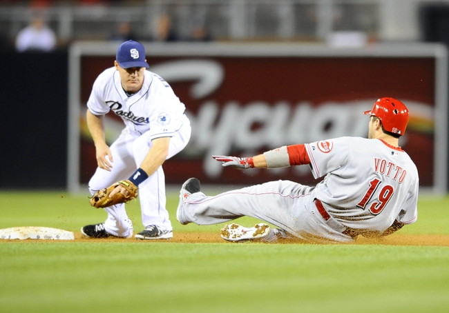 Jul 29, 2013; San Diego, CA, USA; Cincinnati Reds first baseman Joey Votto (19) is tagged out at second base by San Diego Padres second baseman Logan Forsythe (11) on a double attempt during the seventh inning at Petco Park. . Mandatory Credit: Christopher Hanewinckel-USA TODAY Sports