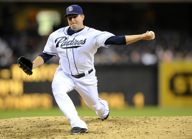Jul 29, 2013; San Diego, CA, USA; San Diego Padres relief pitcher Joe Thatcher (54) throws during the seventh inning against the Cincinnati Reds at Petco Park. . Mandatory Credit: Christopher Hanewinckel-USA TODAY Sports