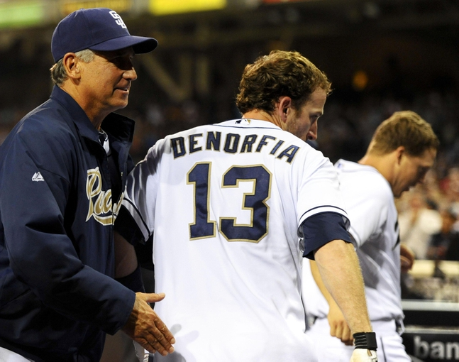 Jul 29, 2013; San Diego, CA, USA; San Diego Padres pinch hitter Chris Denorfia (13) is congratulated by manager Bud Black (left) after a game-winning two-run home run during the ninth inning against the Cincinnati Reds at Petco Park. Mandatory Credit: Christopher Hanewinckel-USA TODAY Sports
