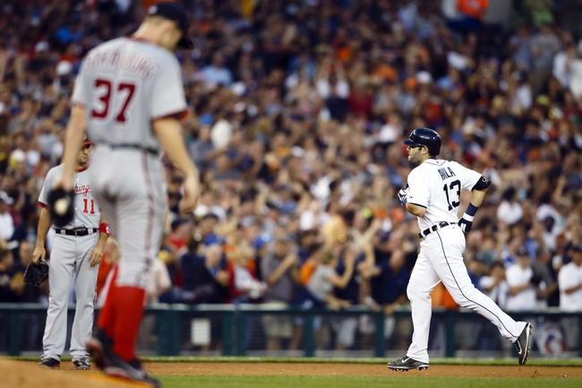 Jul 30, 2013; Detroit, MI, USA; Detroit Tigers catcher Alex Avila (13) runs the bases after he hits a grand slam home run off Washington Nationals starting pitcher Stephen Strasburg (37) in the sixth inning at Comerica Park. Mandatory Credit: Rick Osentoski-USA TODAY Sports