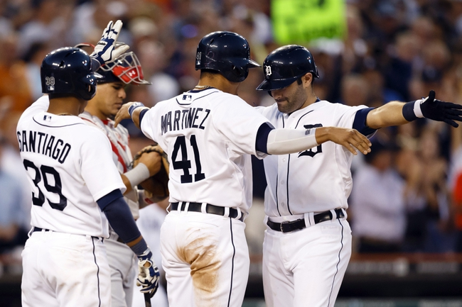 Jul 30, 2013; Detroit, MI, USA; Detroit Tigers catcher Alex Avila (13) receives congratulations from designated hitter Victor Martinez (41) and second baseman Ramon Santiago (39) after he hits a grand slam home run in the sixth inning against the Washington Nationals at Comerica Park. Mandatory Credit: Rick Osentoski-USA TODAY Sports
