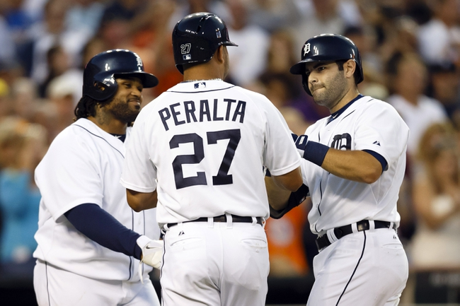 Jul 30, 2013; Detroit, MI, USA; Detroit Tigers catcher Alex Avila (13) receives congratulations from shortstop Jhonny Peralta (27) and first baseman Prince Fielder (28) after he hits a grand slam home run in the sixth inning against the Washington Nationals at Comerica Park. Mandatory Credit: Rick Osentoski-USA TODAY Sports
