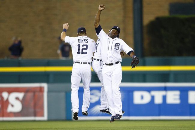 Jul 30, 2013; Detroit, MI, USA; Detroit Tigers left fielder Andy Dirks (12) right fielder Torii Hunter (48) and center fielder Austin Jackson (14) celebrate after the game against the Washington Nationals at Comerica Park. Detroit won 5-1. Mandatory Credit: Rick Osentoski-USA TODAY Sports