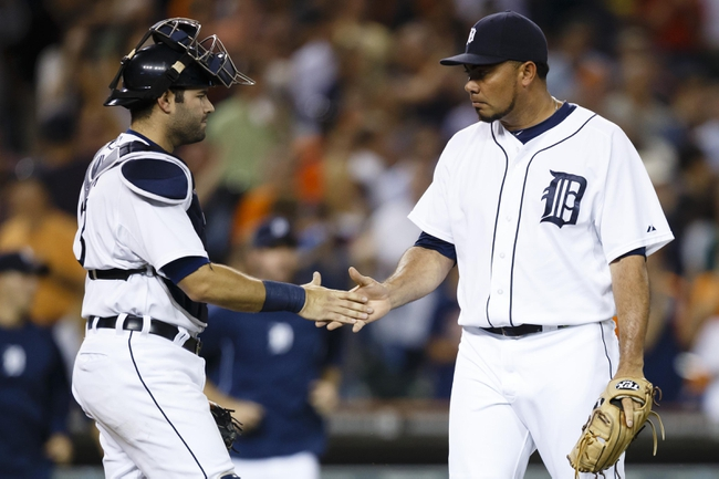 Jul 30, 2013; Detroit, MI, USA; Detroit Tigers catcher Alex Avila (13) and relief pitcher Joaquin Benoit (53) celebrate after the game against the Washington Nationals at Comerica Park. Detroit won 5-1. Mandatory Credit: Rick Osentoski-USA TODAY Sports