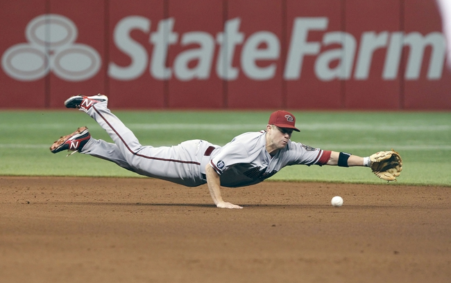 Jul 30, 2013; St. Petersburg, FL, USA; Arizona Diamondbacks second baseman Aaron Hill (2) dives after the ball as he misses it during the sixth inning against the Tampa Bay Rays at Tropicana Field. Mandatory Credit: Kim Klement-USA TODAY Sports