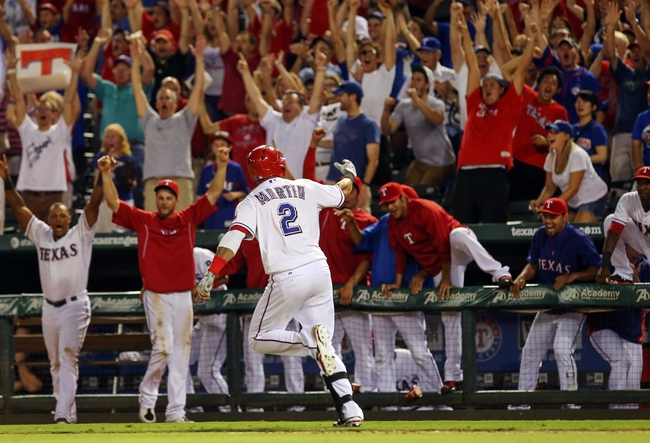 Jul 30, 2013; Arlington, TX, USA; Texas Rangers left fielder Leonys Martin (2) hits a walk off home run to beat the Los Angeles Angels in the tenth inning at Rangers Ballpark in Arlington . Mandatory Credit: Kevin Jairaj-USA TODAY Sports