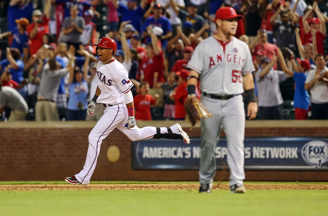 Jul 30, 2013; Arlington, TX, USA; Texas Rangers left fielder Leonys Martin (2) celebrates as he rounds the bases after hitting a walk off home run to beat the Los Angeles Angels in the tenth inning at Rangers Ballpark in Arlington . Mandatory Credit: Kevin Jairaj-USA TODAY Sports
