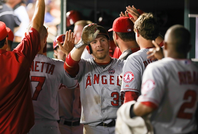 Jul 30, 2013; Arlington, TX, USA; Los Angeles Angels left fielder J.B. Shuck (39) celebrates after scoring  during the game against the Texas Rangers at Rangers Ballpark in Arlington. Mandatory Credit: Kevin Jairaj-USA TODAY Sports