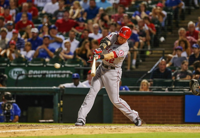 Jul 30, 2013; Arlington, TX, USA; Los Angeles Angels designated hitter Josh Hamilton (32) hits an rbi single during the eight inning against the Texas Rangers at Rangers Ballpark in Arlington. Mandatory Credit: Kevin Jairaj-USA TODAY Sports