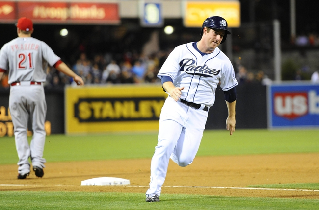 Jul 30, 2013; San Diego, CA, USA; San Diego Padres second baseman Jedd Gyorko (9) rounds third base and scores on a two-run double by catcher Nick Hundley (not pictured) during the eighth inning against the Cincinnati Reds at Petco Park. Mandatory Credit: Christopher Hanewinckel-USA TODAY Sports