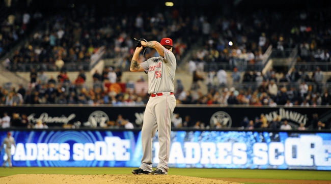 Jul 30, 2013; San Diego, CA, USA; Cincinnati Reds starting pitcher Mat Latos (55) reacts after allowing a run during the sixth inning against the San Diego Padres at Petco Park. Mandatory Credit: Christopher Hanewinckel-USA TODAY Sports