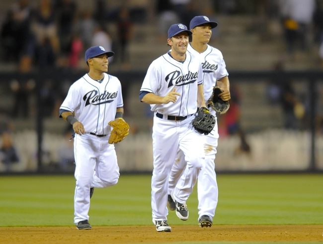 Jul 30, 2013; San Diego, CA, USA; San Diego Padres center fielder Alexi Amarista (left), left fielder Chris Denorfia (center) and right fielder Will Venable (25) celebrate after a 4-2 win against the Cincinnati Reds at Petco Park. Mandatory Credit: Christopher Hanewinckel-USA TODAY Sports