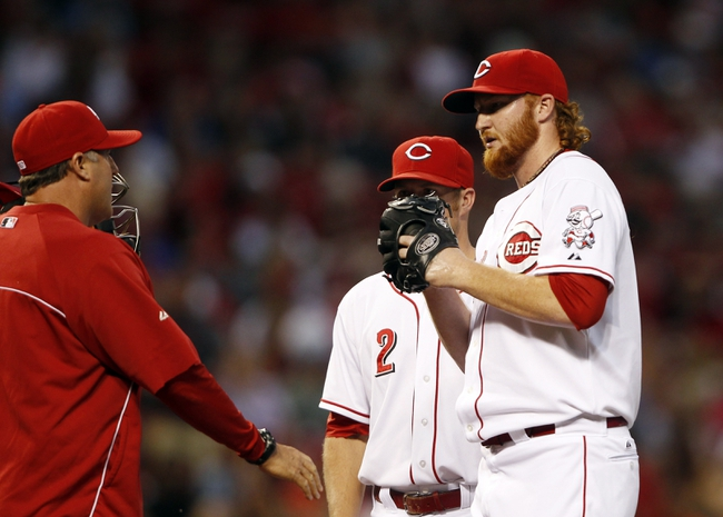 Aug 2, 2013; Cincinnati, OH, USA; Cincinnati Reds pitching coach Bryan Price (left) goes to the mound to talk to relief pitcher Curtis Partch (46) during the fourth inning against the St. Louis Cardinals at Great American Ball Park. Mandatory Credit: Frank Victores-USA TODAY Sports