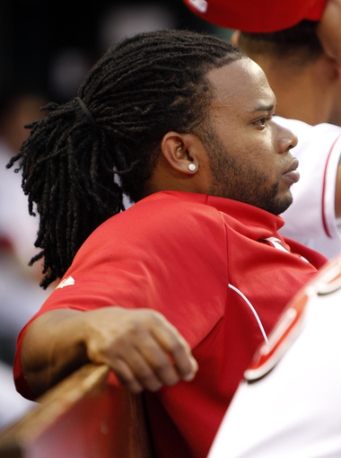 Aug 2, 2013; Cincinnati, OH, USA; Cincinnati Reds injured starting pitcher Johnny Cueto (47) in the dug out during the third inning against the St. Louis Cardinals at Great American Ball Park. Mandatory Credit: Frank Victores-USA TODAY Sports