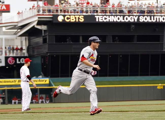 Aug 2, 2013; Cincinnati, OH, USA; St. Louis Cardinals third baseman David Freese (23) rounds third base on his way to score during the first inning against the Cincinnati Reds at Great American Ball Park. Mandatory Credit: Frank Victores-USA TODAY Sports