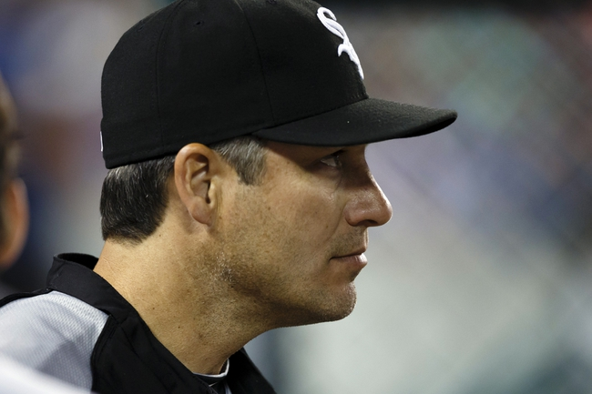 Aug 3, 2013; Detroit, MI, USA; Chicago White Sox manager Robin Ventura (23) watches from the dugout in the eighth inning against the Detroit Tigers at Comerica Park. Mandatory Credit: Rick Osentoski-USA TODAY Sports