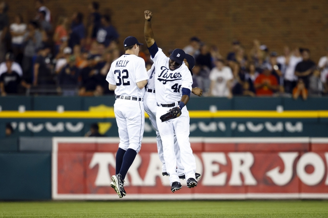 Aug 3, 2013; Detroit, MI, USA; Detroit Tigers players Don Kelly (32) , Victor Martinez (41) and Austin Jackson (14) celebrate after the game against the Chicago White Sox at Comerica Park. Detroit won 3-0. Mandatory Credit: Rick Osentoski-USA TODAY Sports
