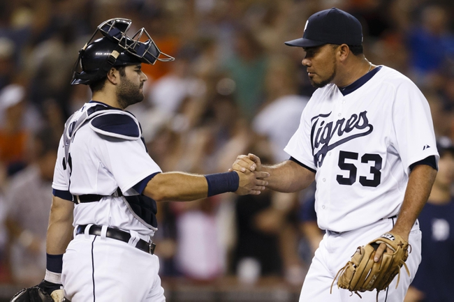 Aug 3, 2013; Detroit, MI, USA; Detroit Tigers catcher Alex Avila (13) and relief pitcher Joaquin Benoit (53) celebrate after the game against the Chicago White Sox at Comerica Park. Detroit won 3-0. Mandatory Credit: Rick Osentoski-USA TODAY Sports