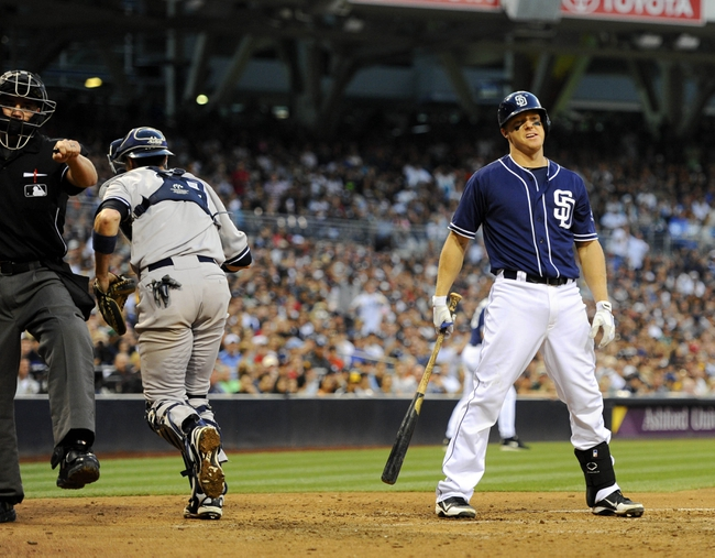Aug 3, 2013; San Diego, CA, USA; San Diego Padres catcher Nick Hundley (4) reacts after a called strike three by home plate umpire Scott Barry (left) during the seventh inning against the New York Yankees at Petco Park. Mandatory Credit: Christopher Hanewinckel-USA TODAY Sports