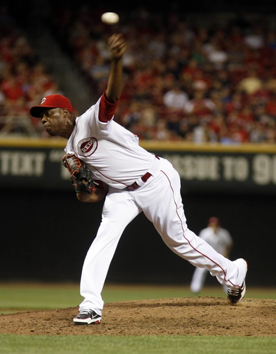 Aug 3, 2013; Cincinnati, OH, USA; Cincinnati Reds relief pitcher Aroldis Chapman (54) throws against the St. Louis Cardinals in the ninth inning at Great American Ball Park. The Reds won 8-3. Mandatory Credit: David Kohl-USA TODAY Sports