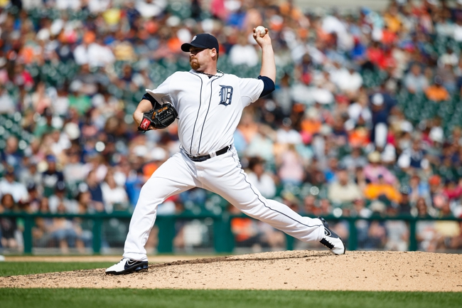 Jul 28, 2013; Detroit, MI, USA; Detroit Tigers relief pitcher Phil Coke (40) pitches against the Philadelphia Phillies at Comerica Park. Mandatory Credit: Rick Osentoski-USA TODAY Sports