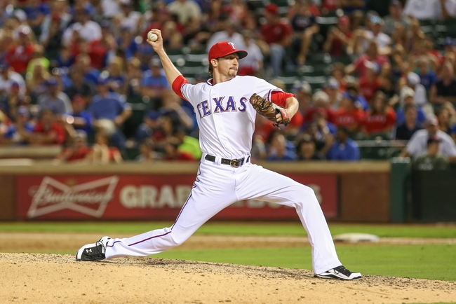 Jul 30, 2013; Arlington, TX, USA; Texas Rangers relief pitcher Tanner Scheppers (52) throws during the game against the Los Angeles Angels at Rangers Ballpark in Arlington. Texas won 14-11.  Mandatory Credit: Kevin Jairaj-USA TODAY Sports