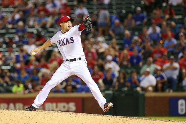 Jul 30, 2013; Arlington, TX, USA; Texas Rangers relief pitcher Jason Frasor (44) throws during the game against the Los Angeles Angels at Rangers Ballpark in Arlington. Texas won 14-11.  Mandatory Credit: Kevin Jairaj-USA TODAY Sports