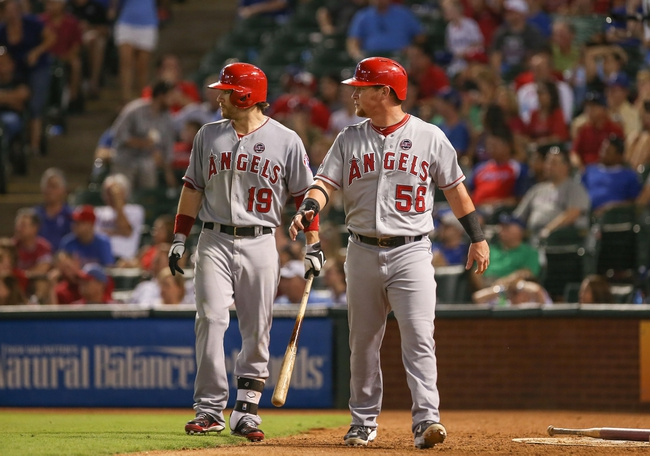 Jul 30, 2013; Arlington, TX, USA; Los Angeles Angels rightfielder Collin Cowgill (19) and left fielder Kole Calhoun (56) react during the game against the Texas Rangers at Rangers Ballpark in Arlington. Texas won 14-11.  Mandatory Credit: Kevin Jairaj-USA TODAY Sports
