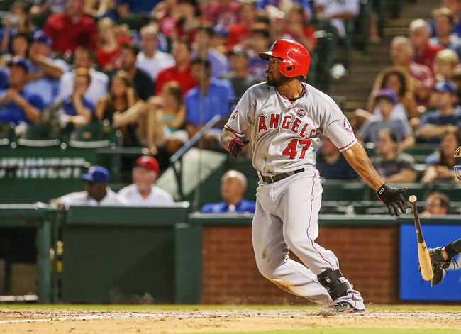 Jul 30, 2013; Arlington, TX, USA; Los Angeles Angels second baseman Howie Kendrick (47) bats during the game against the Texas Rangers at Rangers Ballpark in Arlington. Texas won 14-11.  Mandatory Credit: Kevin Jairaj-USA TODAY Sports
