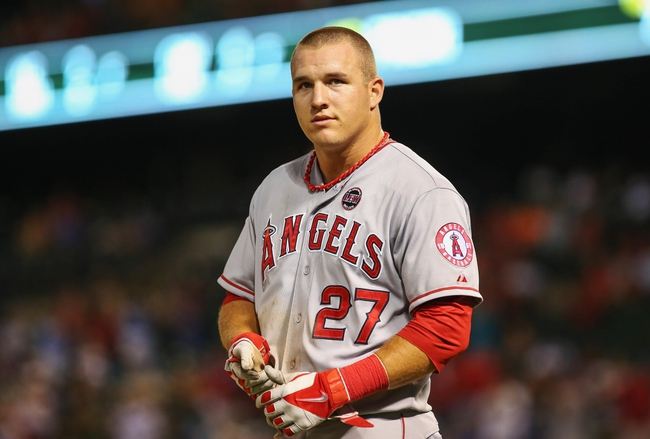 Jul 30, 2013; Arlington, TX, USA; Los Angeles Angels center fielder Mike Trout (27) reacts during the game against the Texas Rangers at Rangers Ballpark in Arlington. Texas won 14-11.  Mandatory Credit: Kevin Jairaj-USA TODAY Sports