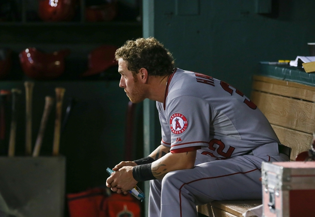 Jul 30, 2013; Arlington, TX, USA; Los Angeles Angels designated hitter Josh Hamilton (32) sits in the dugout during the game against the Texas Rangers at Rangers Ballpark in Arlington. Texas won 14-11.  Mandatory Credit: Kevin Jairaj-USA TODAY Sports