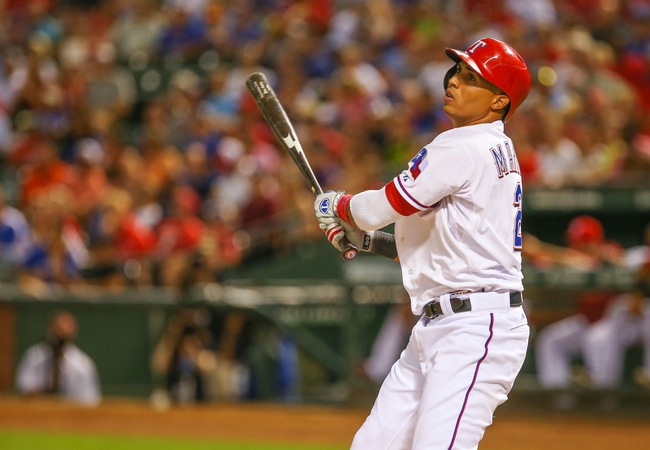 Jul 30, 2013; Arlington, TX, USA; Texas Rangers left fielder Leonys Martin (2) bats during the game against the Los Angeles Angels at Rangers Ballpark in Arlington. Texas won 14-11.  Mandatory Credit: Kevin Jairaj-USA TODAY Sports