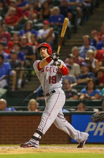 Jul 30, 2013; Arlington, TX, USA; Los Angeles Angels right fielder Collin Cowgill (19) bats during the game against the Texas Rangers at Rangers Ballpark in Arlington. Texas won 14-11.  Mandatory Credit: Kevin Jairaj-USA TODAY Sports
