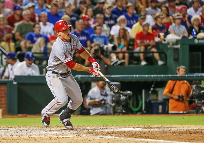 Jul 30, 2013; Arlington, TX, USA; Los Angeles Angels center fielder Mike Trout (27) bats during the game against the Texas Rangers at Rangers Ballpark in Arlington. Texas won 14-11.  Mandatory Credit: Kevin Jairaj-USA TODAY Sports