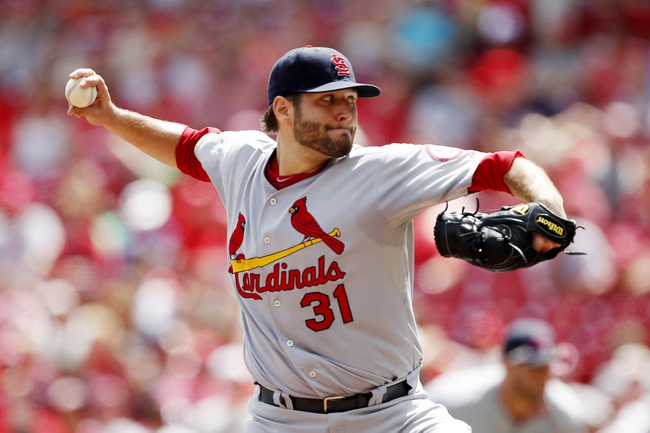 Aug 4, 2013; Cincinnati, OH, USA; St. Louis Cardinals starting pitcher Lance Lynn (31) pitches during the eighth inning against the Cincinnati Reds at Great American Ball Park. The Cardinals defeated the Reds 15-2. Mandatory Credit: Frank Victores-USA TODAY Sports