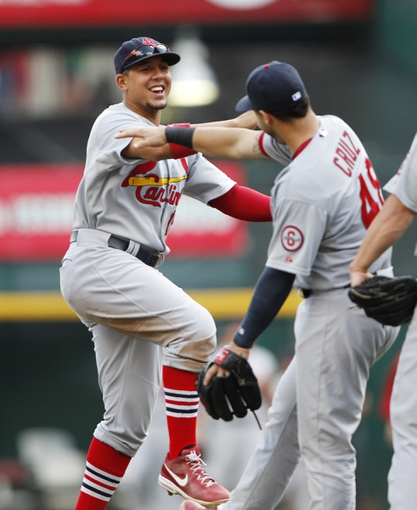 Aug 4, 2013; Cincinnati, OH, USA; St. Louis Cardinals center fielder Jon Jay (19) celebrates with catcher Tony Cruz (48) at the end of the game against the Cincinnati Reds at Great American Ball Park. The Cardinals defeated the Reds 15-2. Mandatory Credit: Frank Victores-USA TODAY Sports