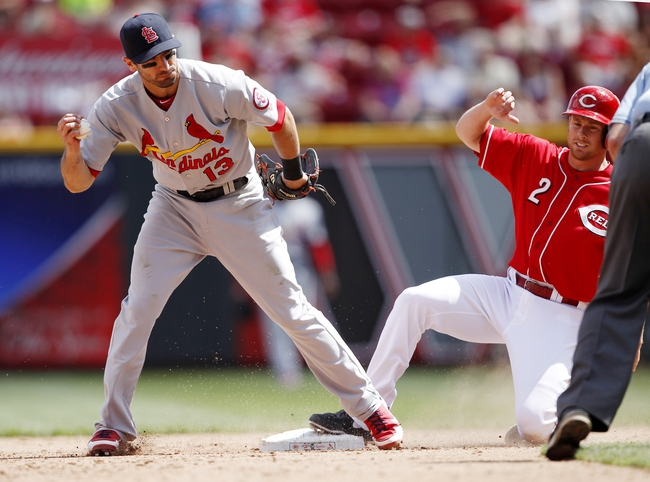 Aug 4, 2013; Cincinnati, OH, USA; Cincinnati Reds shortstop Zack Cozart (2) is forced out during the eighth inning by the St. Louis Cardinals second baseman Matt Carpenter (13) at Great American Ball Park. The Cardinals defeated the Reds 15-2. Mandatory Credit: Frank Victores-USA TODAY Sports