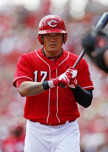 Aug 4, 2013; Cincinnati, OH, USA; Cincinnati Reds center fielder Shin-Soo Choo (17) prepares to bat during the first inning against the St. Louis Cardinals at Great American Ball Park. Mandatory Credit: Frank Victores-USA TODAY Sports