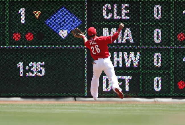 Aug 4, 2013; Cincinnati, OH, USA; Cincinnati Reds left fielder Xavier Paul (26) makes a play during the second inning against the St. Louis Cardinals at Great American Ball Park. Mandatory Credit: Frank Victores-USA TODAY Sports