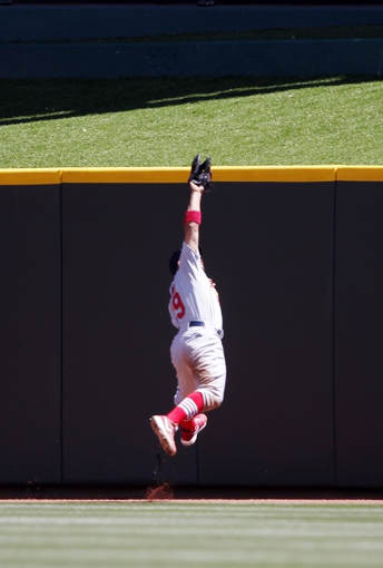 Aug 4, 2013; Cincinnati, OH, USA; St. Louis Cardinals center fielder Jon Jay (19) makes a play during the fourth inning against the Cincinnati Reds at Great American Ball Park. Mandatory Credit: Frank Victores-USA TODAY Sports