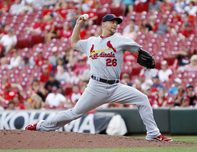 Aug 4, 2013; Cincinnati, OH, USA; St. Louis Cardinals relief pitcher Trevor Rosenthal (26) pitches during the ninth inning against the Cincinnati Reds at Great American Ball Park. The Cardinals defeated the Reds 15-2. Mandatory Credit: Frank Victores-USA TODAY Sports